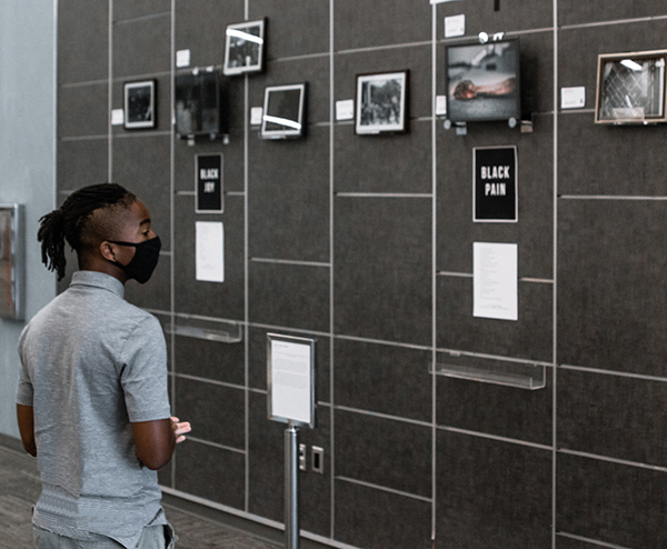Student looking at exhibit